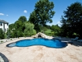 Cranbury freeform pool with rock waterfall and pool slide